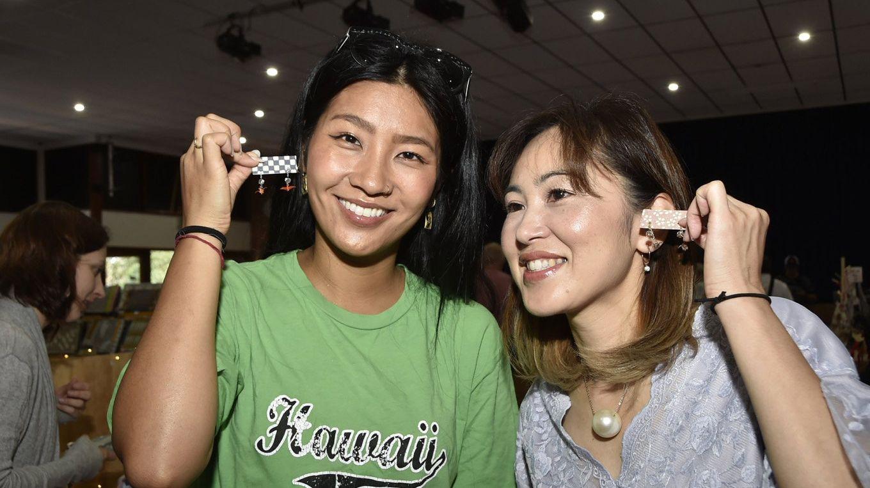 ARTISAN GOODS: Trying on handmade jewellery at the Toowoomba Handmade Expo Market is Sayo Kawahira (left) and Masami Murata.