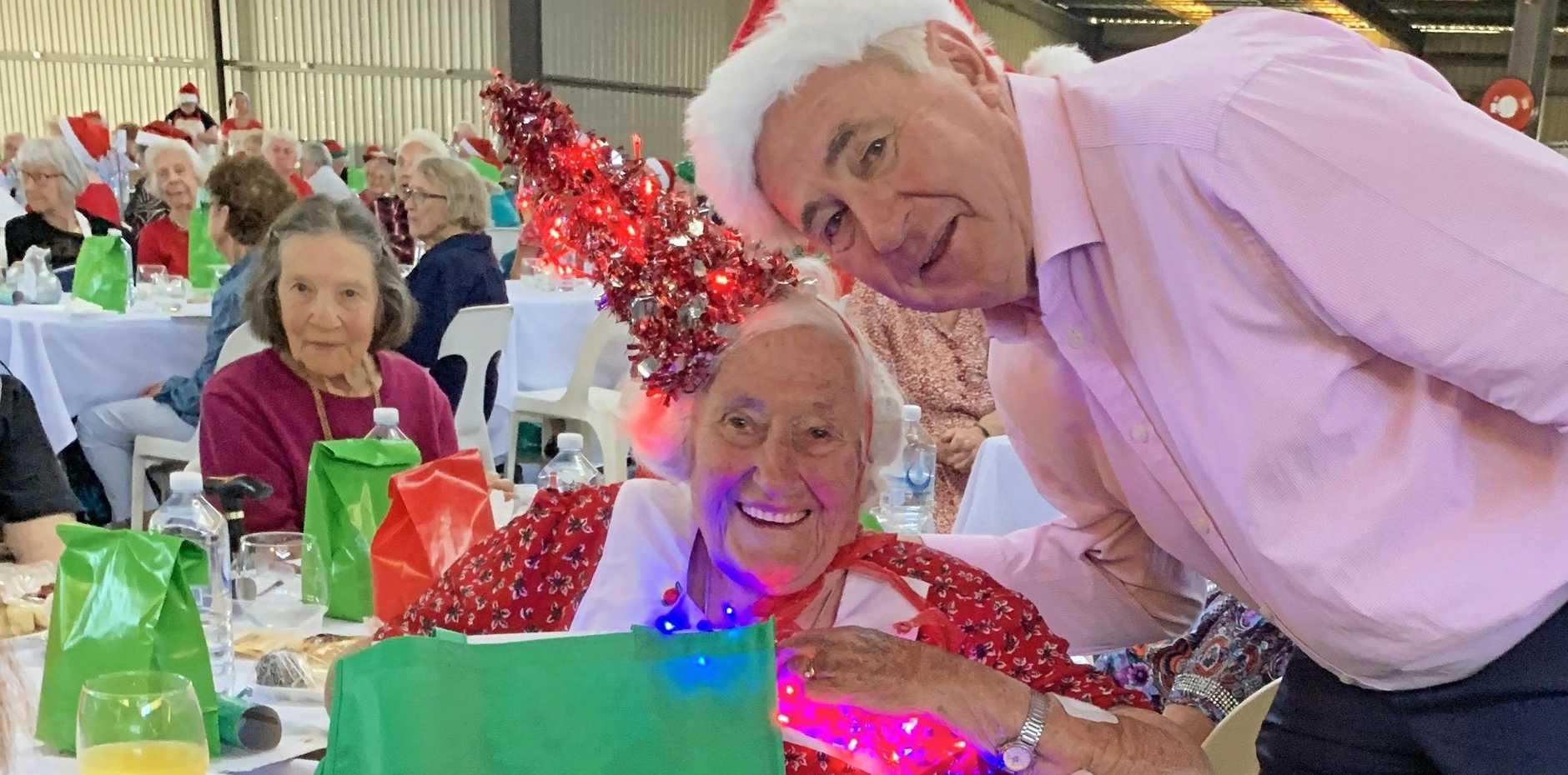 HAPPY DAYS: Mayor Paul Antonio shares a festive moment with resident Kathleen Davey.