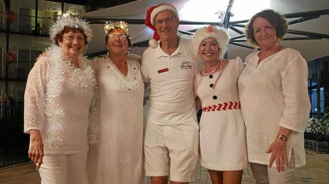 FESTIVE FUN: Kay Linchan, Lydie Martin, Dewi Hughes, Jane Seymour and Maureen Gallichan got into the White Christmas Wonderland theme at the Airlie Beach Bridge Congress last weekend.
