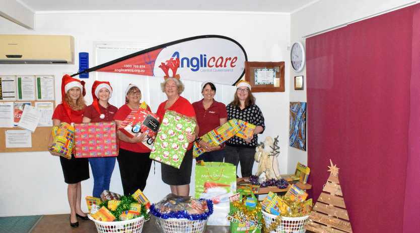 CARING COMMUNITY: Anglicare CQ with donated presents for the Christmas Adopt-A-Family Appeal.