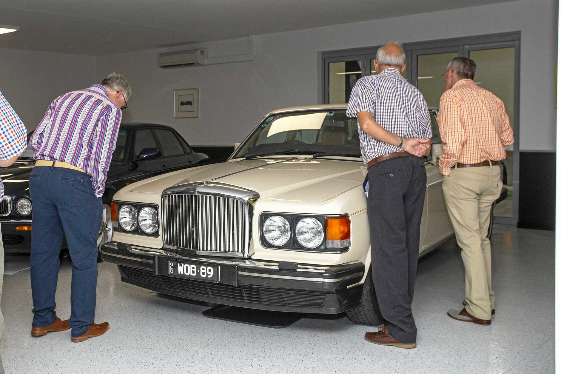 Guests check out a 1989 Bentley.