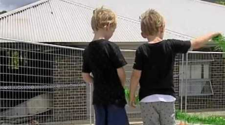 Kai and Ryan observe the damage done to their grandma's house in a fire on Tuesday.