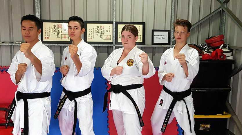 Moranbah Shotokan Karate Club students Huey Head (16), Roger Head (15), Kya Mills (16), and Ethan Condon (15), who have been training for over six years and graded to Shodan (First Dan Blackbelt) last year.