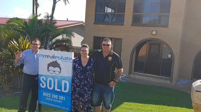 HAPPY BUYERS: Mr Real Estate principal Jason Rayner with delighted property purchasers Belinda Wonson and David Thorburn.