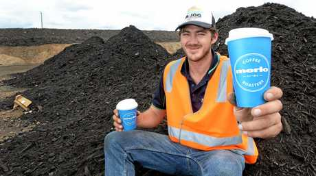NuGrow Ipswich site supervisor Gregg Ellis with the recyclable Merlo cups that gets turned into the mulch behind him.