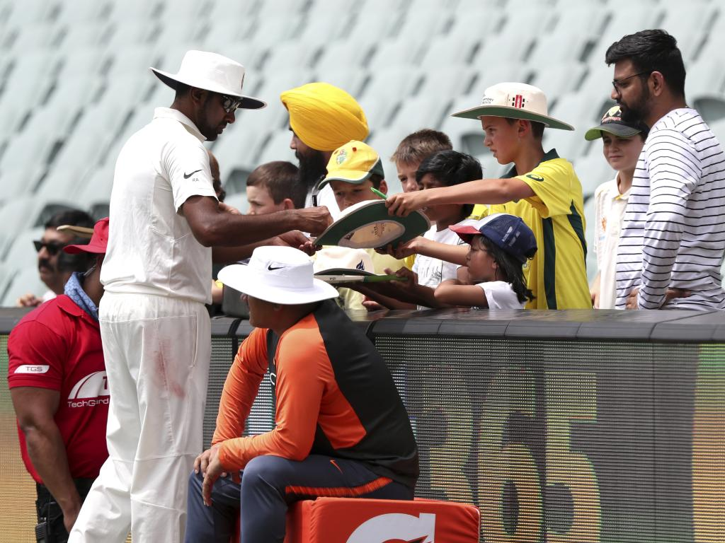 India's Ravi Ashwin signing autographs for fans on Friday. He was India's outstanding bowler. AP Photo/James Elsby