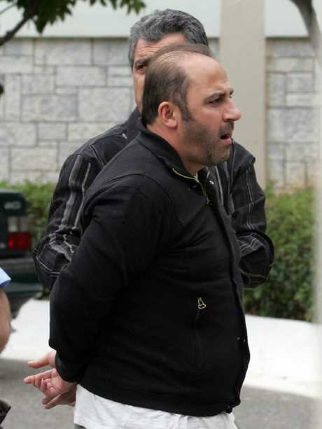 Gotcha: Mokbel being moved to an Athens jail in preparation for his extradition to Australia. Picture: Tim Anderson