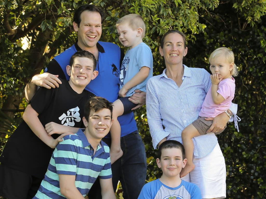 Senator Matt Canavan and wife Andrea at their Yeppoon home with (clockwise from left) Jack, 12, Edward, 4, Beth, 12 months, Henry, 9, and William, 13. Picture: Mark Cranitch
