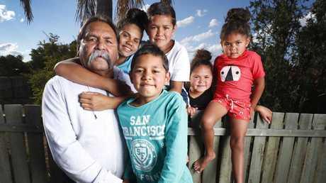 Bevan Costello with grandchildren Darius, 7, (front) Aquilla, 13, Quinci, 8, Mackenzie, 5, and Miha, 9. Picture: Lachie Millard