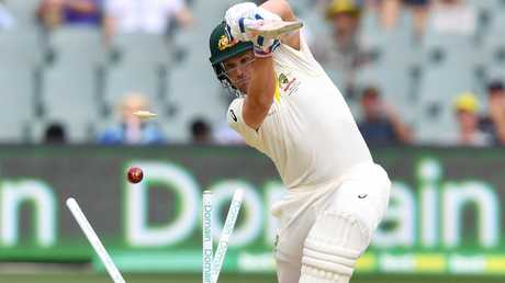 Aaron Finch is bowled for a duck.