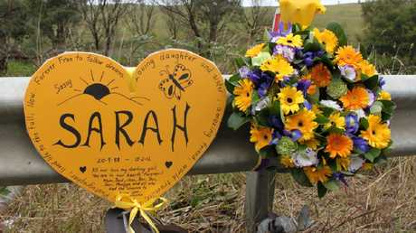 The yellow heart that rests at the spot where Sarah Frazer was killed on the Hume Highway.