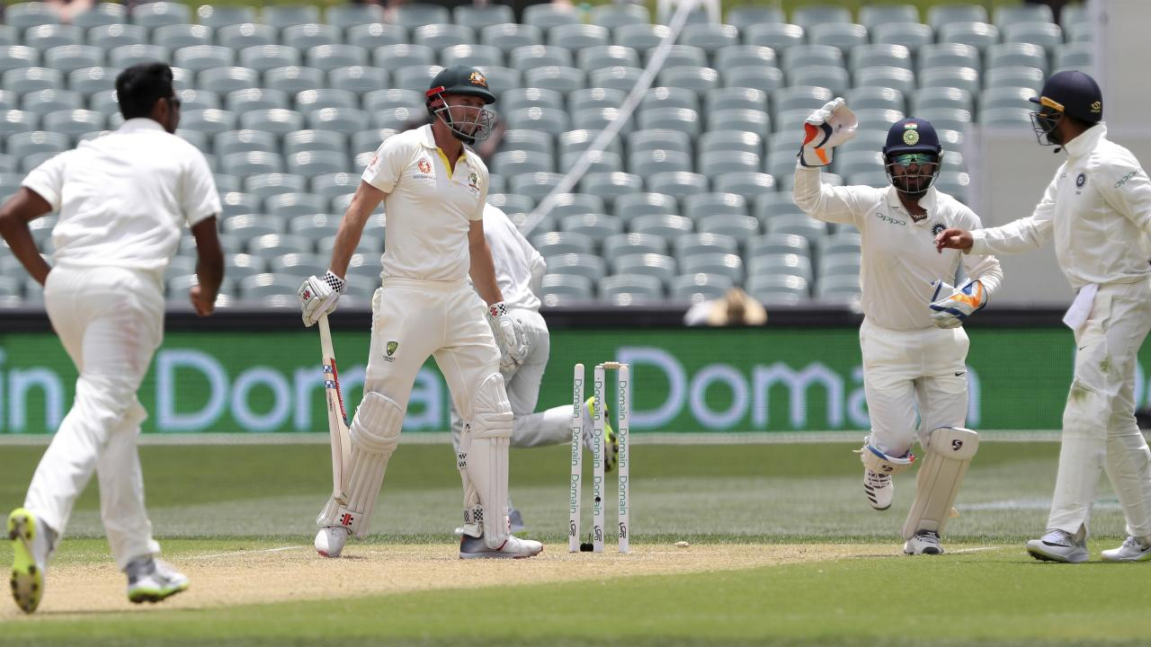 Indian players celebrate after Australia's Shaun Marsh is dismissed during the first Test between Australia and India in Adelaide.