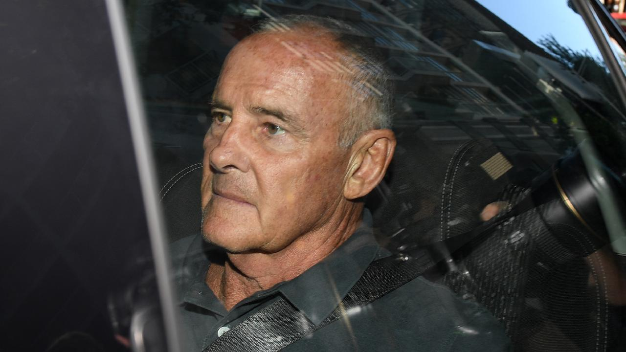 Chris Dawson arrives at Sydney Police Centre after being extradited from Queensland. Picture: Dan Himbrechts