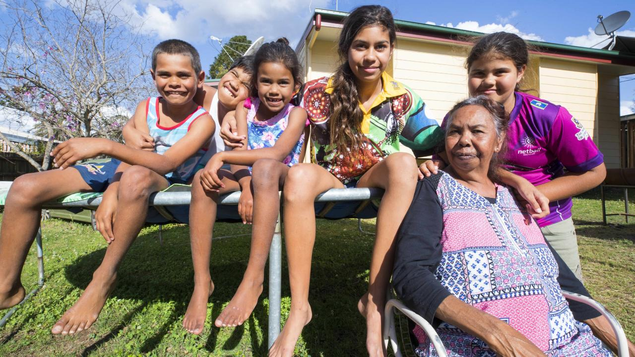 Patricia Douglas with grandchildren Joey, 10, Ian 11, Elvie, 6, Racheal, 13 and Nelliarnah 9, in their backyard at Cherbourg. Picture: Lachie Millard