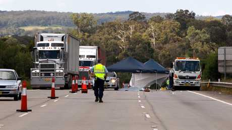 Police at the scene of a double fatality where motorist Sarah Frazer and tow truck driver Geoff Clark were killed when hit by a truck on the Hume Highway near Mittagong in Southern Highlands of NSW.