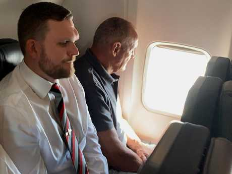 Senior Constable Daniel Poole (left) accompanied Chris Dawson on his extradition from Queensland to Sydney on Thursday. Picture: Lyndon Mechielsen/ The Australian.