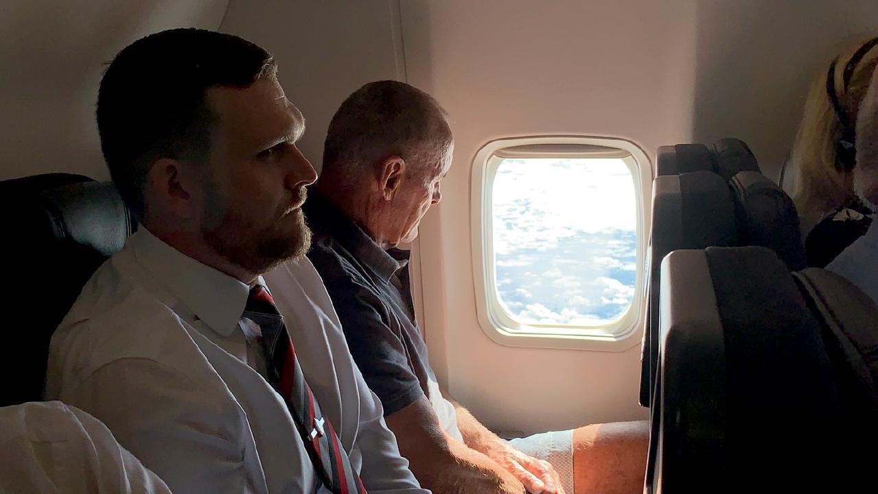 70 year old Chris Dawson is escorted by NSW Police while being flown from Queensland to NSW to face charges of murder over the death of his wife Lyn Dawson. PIC: Lyndon Mechielsen/ The Australian