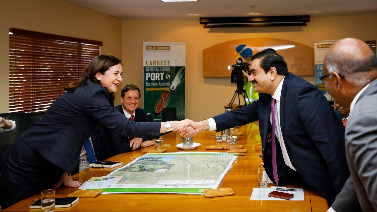 Adani Group chairman Gautam Adani meets with Queensland premier Annastacia Palaszczuk at the Port of Townsville in December 2016. Picture: AAP/Cameron Laird