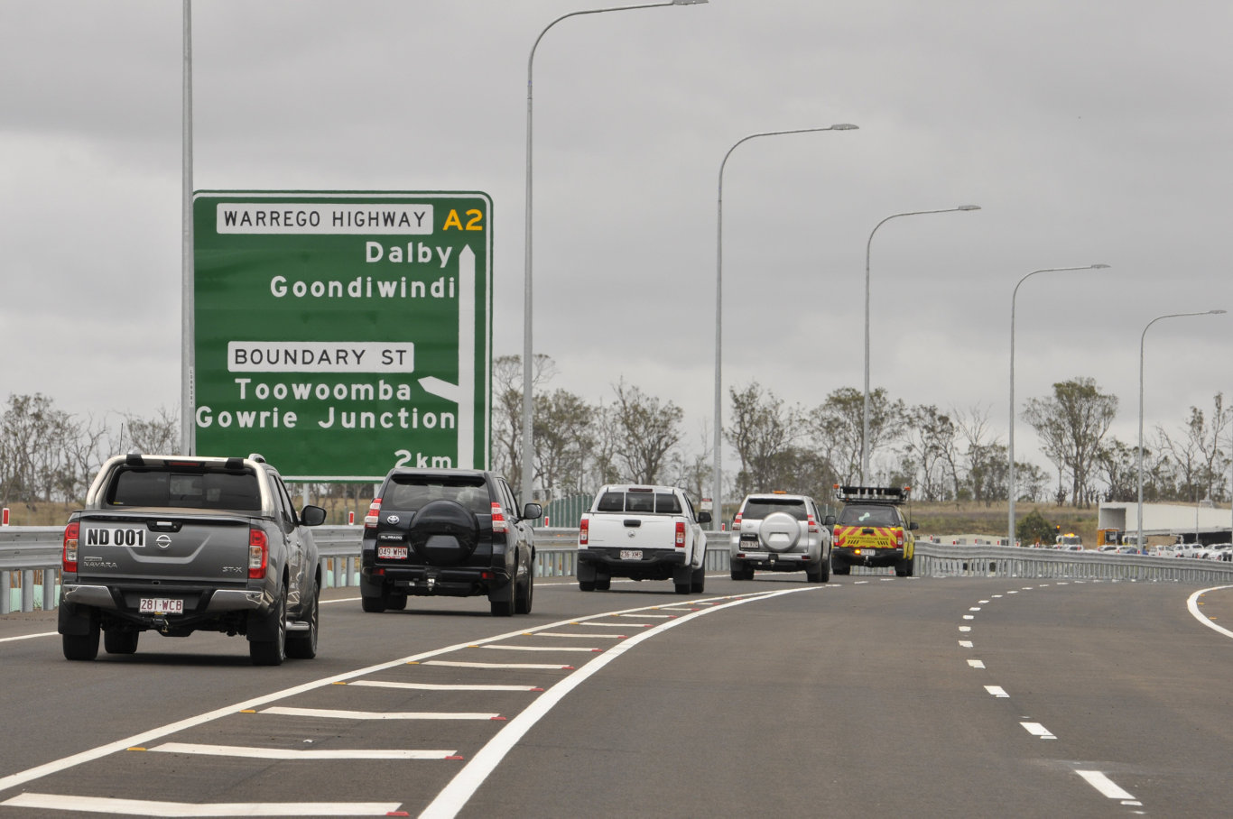 Officials drive in the first convoy of vehicles after the opening of a western section of the Toowoomba Second Range Crossing, Saturday, December 8, 2018.