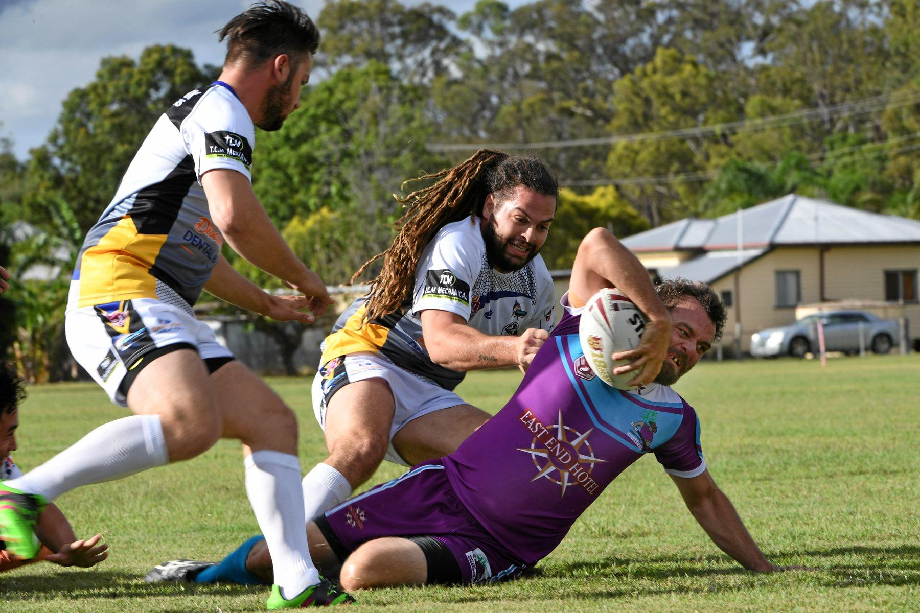 FIND THE LINE: Burnett Cutter Casey Doherty scores a try for last year. The club will find out next year if it can play as its own entity in the Bundaberg Rugby League.