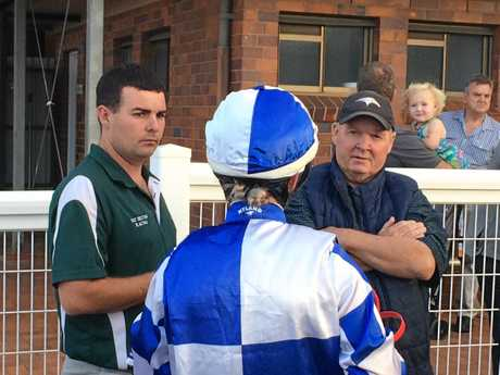 Training partners Mitch Fry (left) and Patrick Sexton chat with jockey Sky Bogenhuber about the performance of third-placegetter Cliveden after the Benchmark 70 Handicap at Clifford Park today.