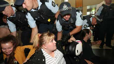 Protesters were forcibly removed by AFP officers from Parliament House in Canberra. Picture: Gary Ramage