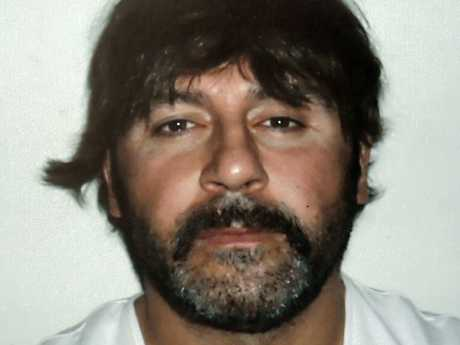 A police handout of Tony Mokbel wearing a wig. Picture: AFP