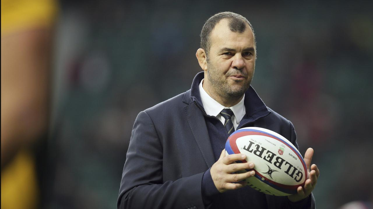 Australia's head coach Michael Cheika watches his players warm-up before the rugby union international between England and Australia at Twickenham in London, Saturday, Nov. 24, 2018. (AP Photo/Tim Ireland)