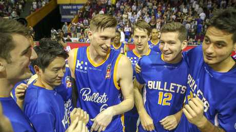 Bullets players celebrate the win. Picture: AAP
