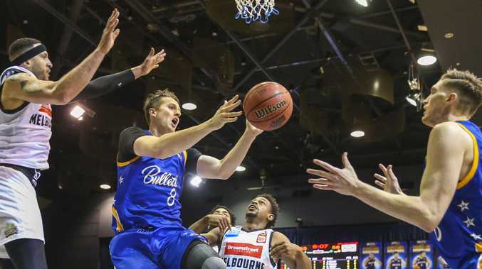 Bullets star Cameron Bairstow passes under the basket on Saturday. Picture: AAP