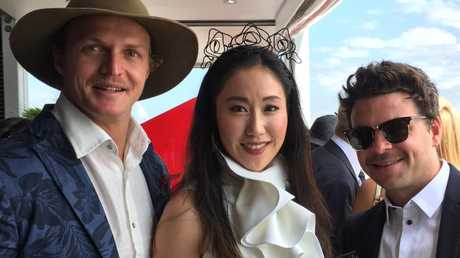 "Welcome to Australia. We're guessing ""Jamie"" Qianqian Wu (centre) probably hadn't met Nick ""Honey Badger"" Cummins (left) before the Melbourne Cup."