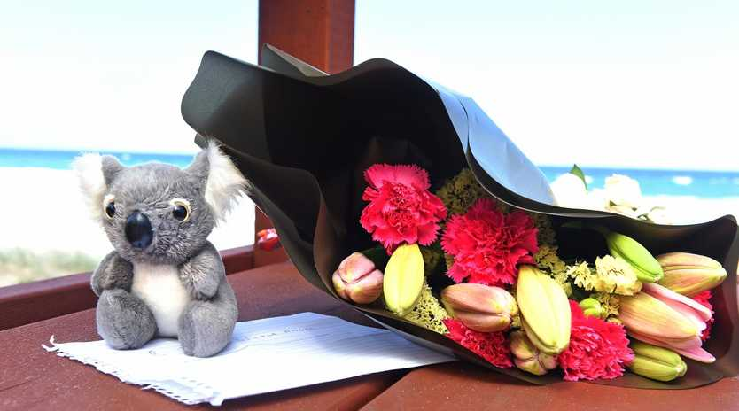 A toy bear and flowers left at the scene where a 9 month old baby was found dead. (AAP image, John Gass)