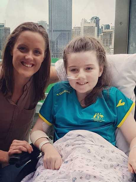 Hannah Papps is visited by paralympian Ellie Cole after she lost her leg in a shark attack.