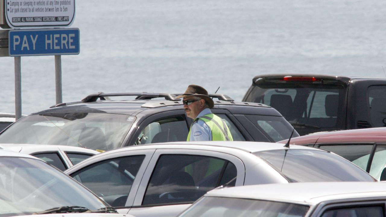 Byron Bay parking officers handing out parking fines. Reporter: Geoff Chambers.