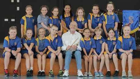 Former Bee Gees drummer Colin Petersen with year 5 students at at Humpybong State School. Picture: Mark Cranitch.