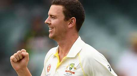 Australia's Josh Hazlewood celebrates taking the wicket of India's Mohammed Shami with the first ball of the day on Friday. Picture: Getty