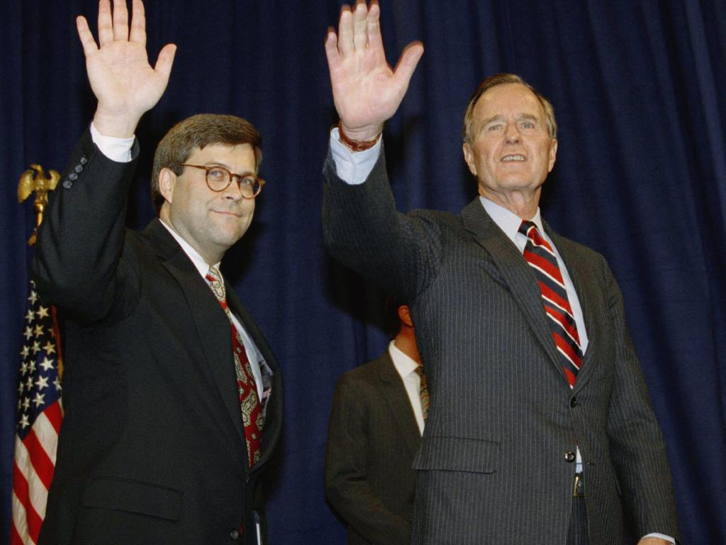 In this November 26, 1991, file photo, President George H.W Bush, right, and William Barr wave after Barr was sworn in as the new Attorney General.  Picture:  AP