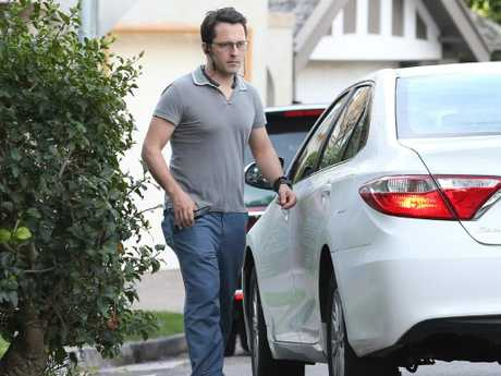 Alex Turnbull getting into an Uber outside his parent's Point Piper mansion. Picture: Hollie Adams.