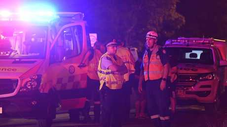 Police and paramedics at the scene of the crash. Picture: Gordon McComiskie