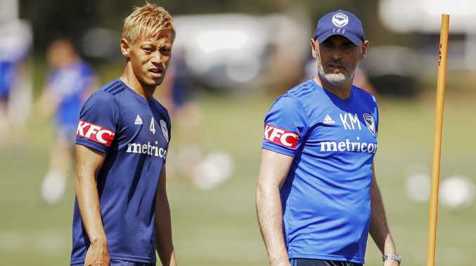 Keisuke Honda with Victory coach Kevin Muscat. Picture: AAP Image/Daniel Pockett