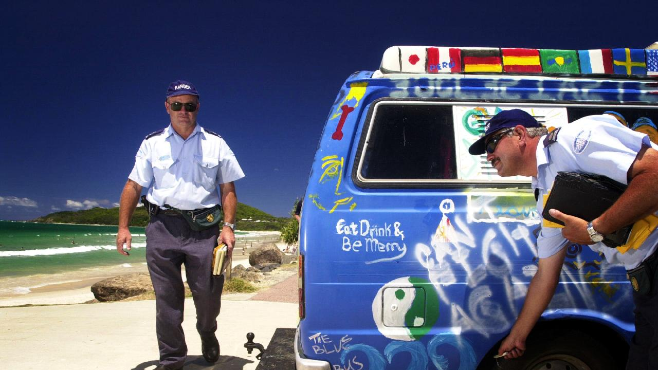 Byron Shire council parking inspectors Scott Brodie and Gerry Burnage enforce parking rules at Byron Bay's Main Beach. Pic Patrick Hamilton. NSW
