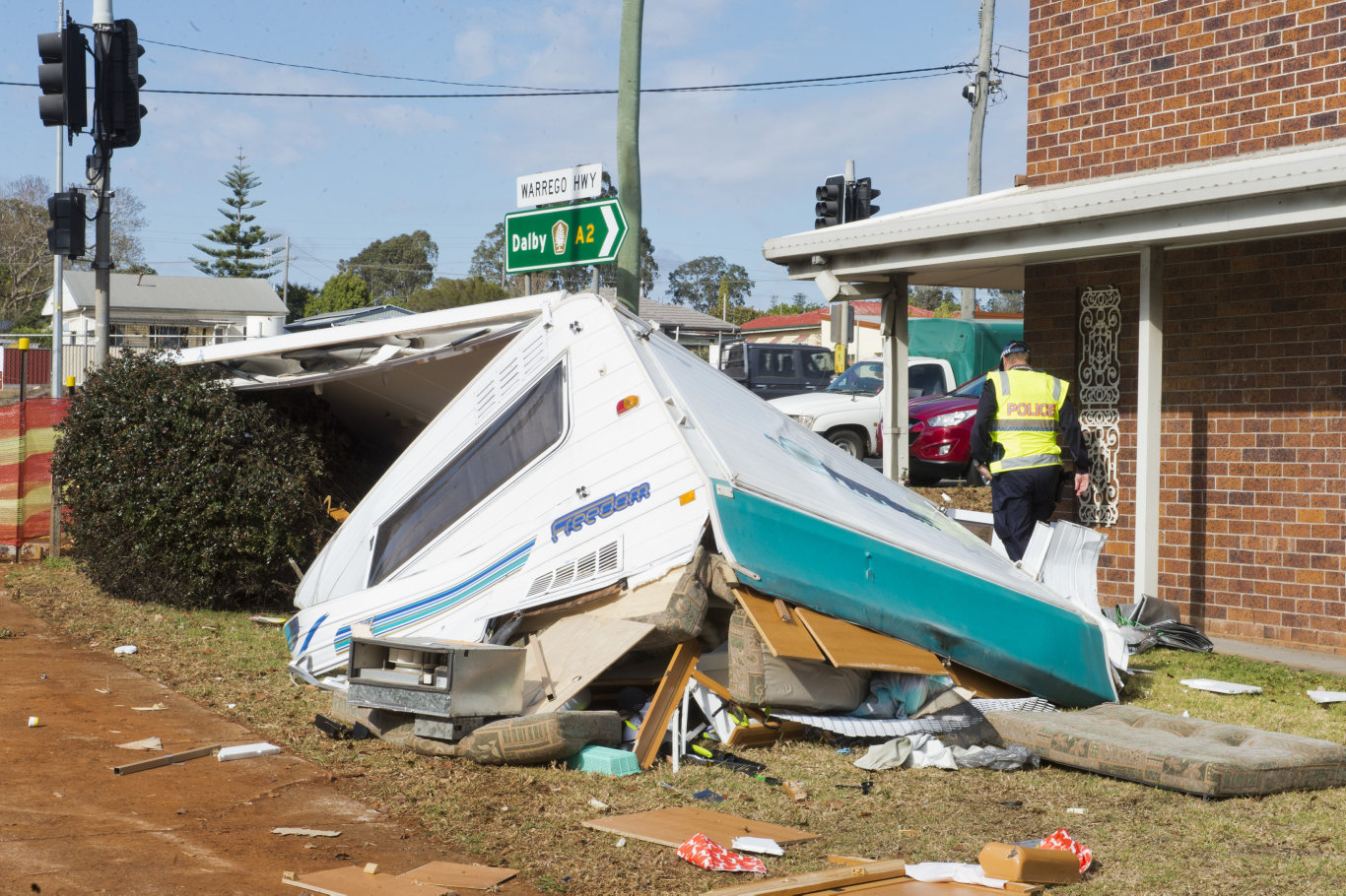 Stolen caravan dislodges from trailer and clips roof of units on corner of Taylor and Tor streets Toowoomba. Wednesday, 26th Sep, 2018.