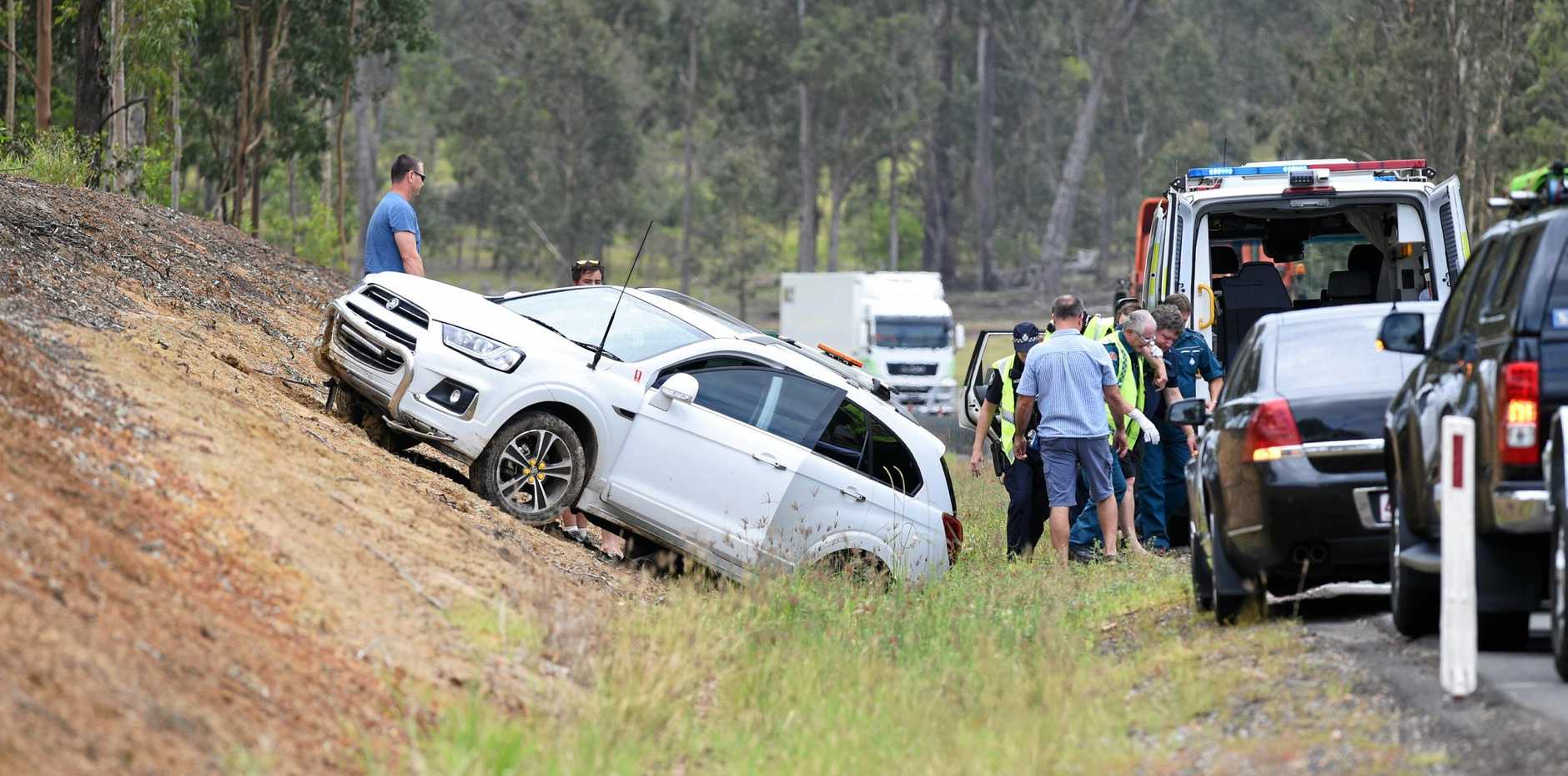 CAR SWERVES: Police on the scene of an accident on the Bruce Hwy south of Tiaro on Saturday.