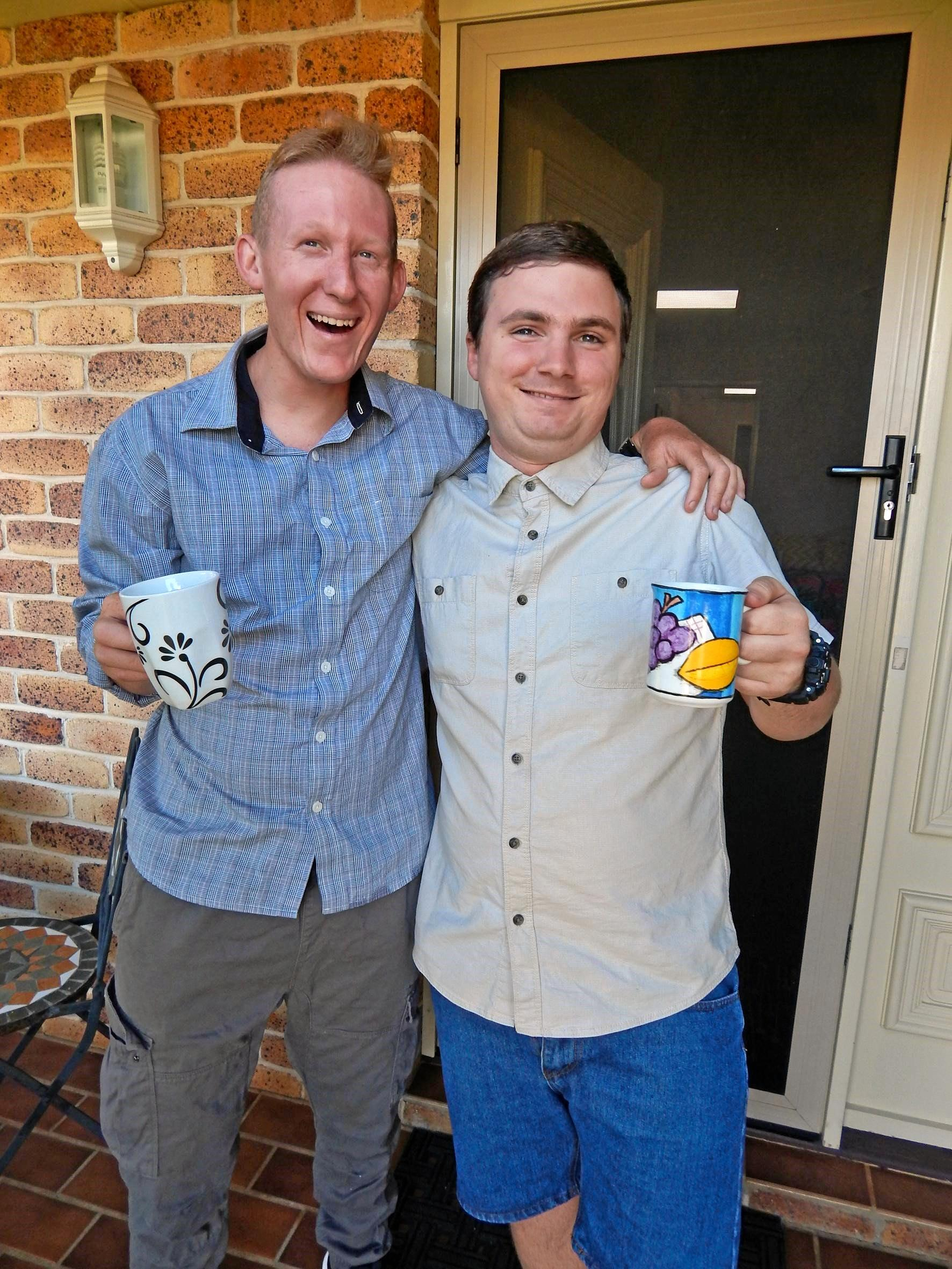 ON A HIGH: Scott Tiran (left) and Matt Morley are living the dream of independent living in Middle Ridge, thanks to the NDIS and Wagtail Services.