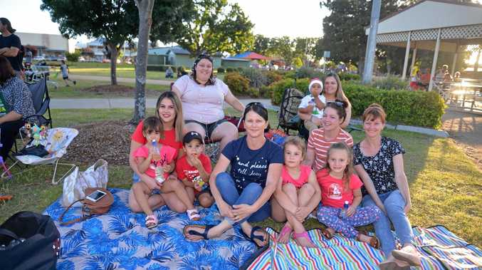 See photos of families spreading cheer at Carols in the Park