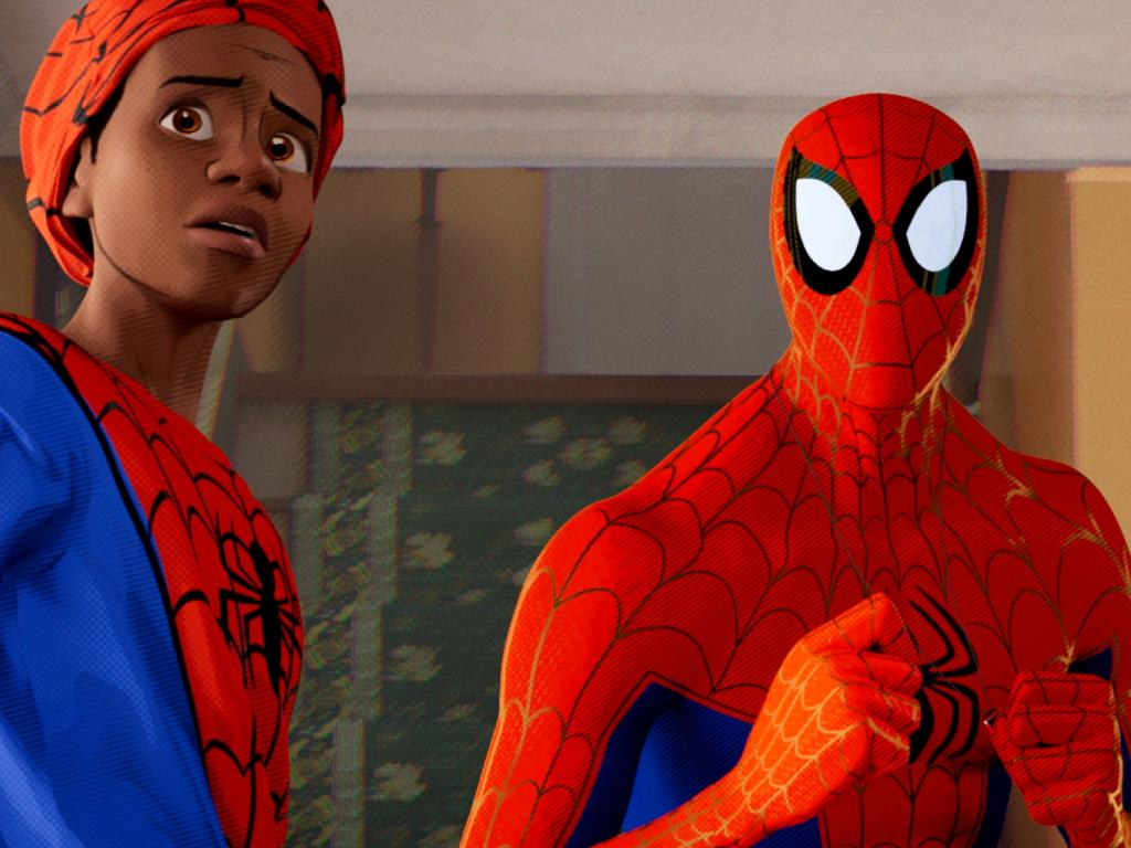 Miles Morales (Shameik Moore), Peter Parker (Jake Johnson) in a scene from Spider-Man: Into the Spider-verse