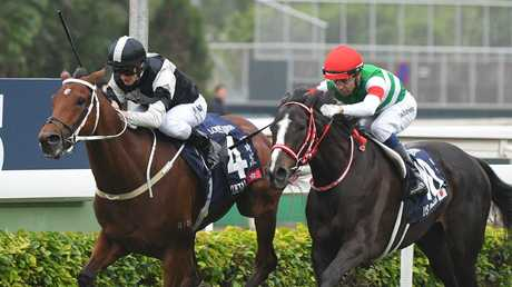 Purton (left) riding Exultant defeats Joao Moreira on Lys Gracieux in the Hong Kong Vase. Picture: Getty Images