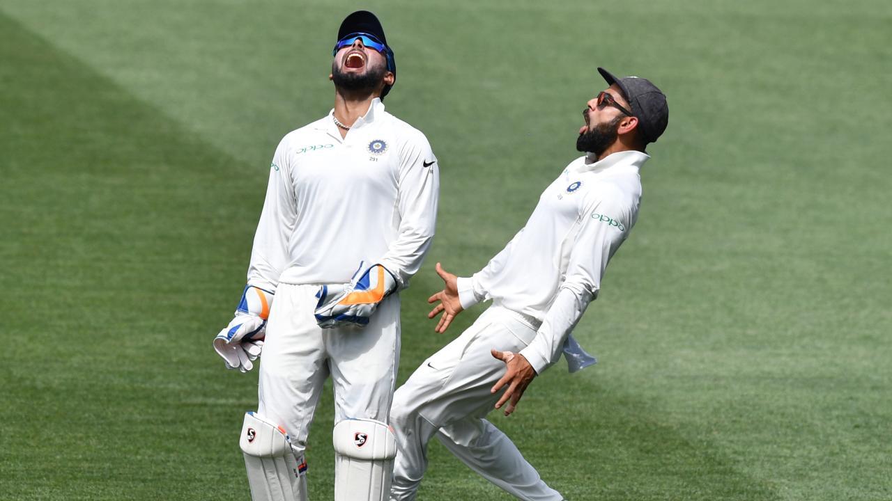 India's Rishabh Pant (left) and Virat Kohli celebrate the dismissal of Marcus Harris. Picture: AAP