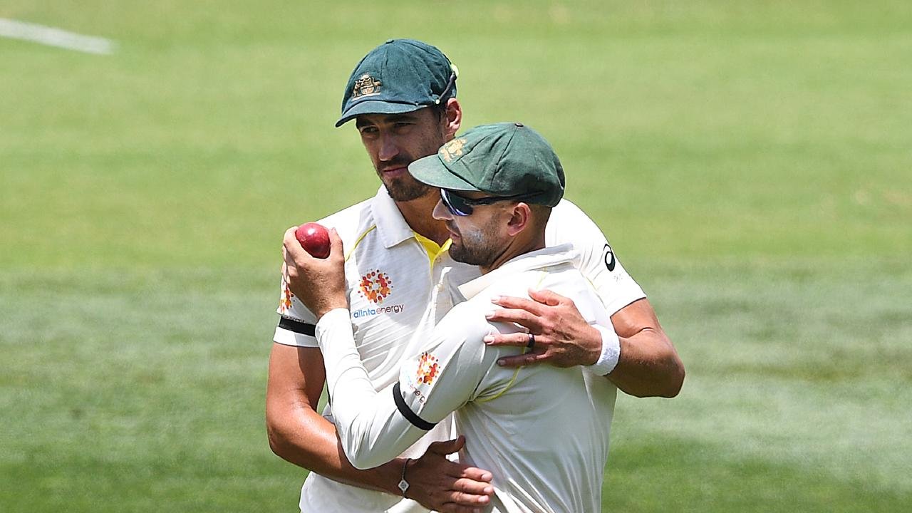 Australian bowler Nathan Lyon (right) is congratulated by Mitchell Starc. Picture: AAP