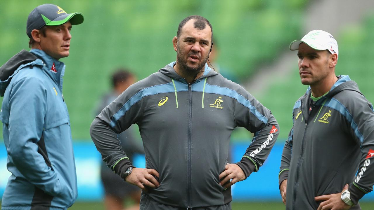 Wallabies coach Michael Cheika talks to assistants Stephen Larkham and Nathan Grey.